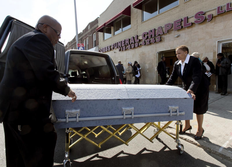 The casket of Jerome Murdough is wheeled to a hearse after his funeral at the Cobbs Funeral Chapel, in the Queens borough of New York, Friday, April 25, 2014. A modest family funeral held for 56-year-old Murdough, a homeless former Marine who was found dead more than two months ago in an overheated New York City jail cell. (AP Photo/Richard Drew)