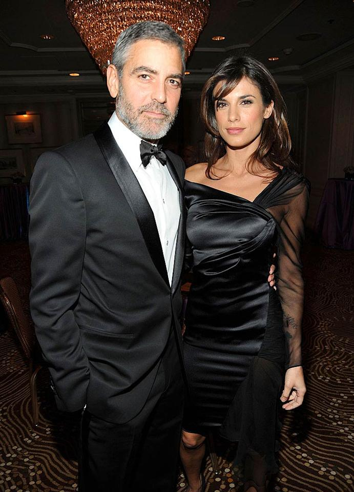 "George Clooney and his Italian girlfriend Elisabetta Canalis arrive at the ball. During the dinner, Clooney presented the Humanitarian of the Year award to producer Jerry Weintraub. ""When it comes to charities, nobody guilts better,"" Clooney joked about Weintraub to the crowd. Kevin Mazur/<a href=""http://www.wireimage.com"" target=""new"">WireImage.com</a> - December 10, 2009"