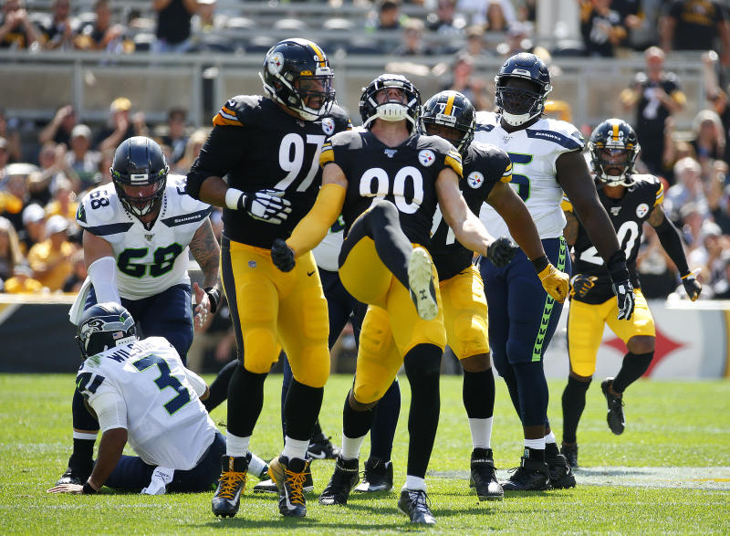 PITTSBURGH, PA - SEPTEMBER 15: T.J. Watt #90 of the Pittsburgh Steelers celebrates with Cameron Heyward #97 and Stephon Tuitt #91 after a sack in the first half against the Seattle Seahawks in the first half on September 15, 2019 at Heinz Field in Pittsburgh, Pennsylvania. (Photo by Justin K. Aller/Getty Images)