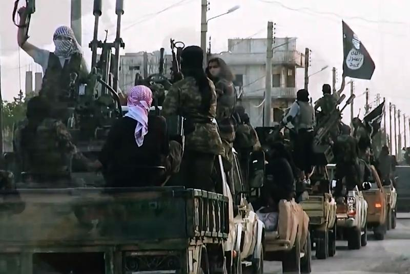 An image grab taken from a propaganda video released on March 17, 2014 by the Islamic State of Iraq and the Levant (ISIL)'s al-Furqan Media allegedly shows ISIL fighters driving on a street in the northern Syrian City of Homs