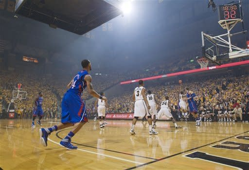 A haze sits over the court as Kansas and Missouri play during the first half of an NCAA college basketball game Saturday, Feb. 4, 2012, in Columbia, Mo. Pregame fireworks caused the haze which hung for the first half of Missouri's 74-71 victory. (AP Photo/L.G. Patterson)