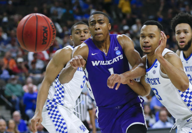 Abilene Christian's Jaren Lewis (1) goes after a loose ball, next to Kentucky's Keldon Johnson (3) and Jemarl Baker Jr., right, during the first half of a first-round game in the NCAA mens college basketball tournament in Jacksonville, Fla. Thursday, March 21, 2019. (AP Photo/Stephen B. Morton)