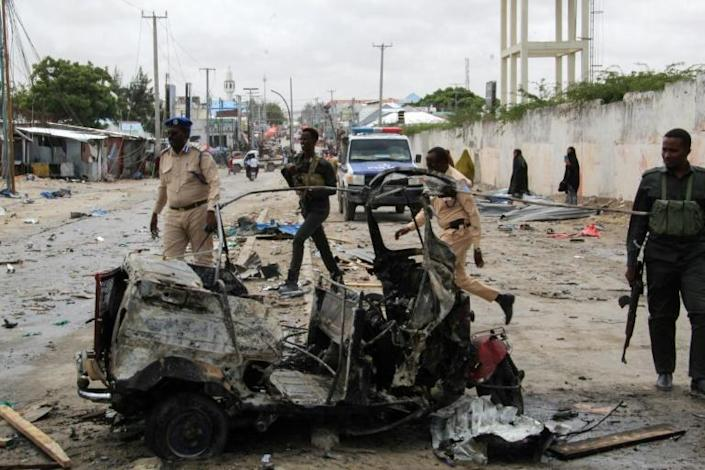 Police officers at the scene of a suicide car bomb attack on July 10 that targeted Mogadishu's police commissioner