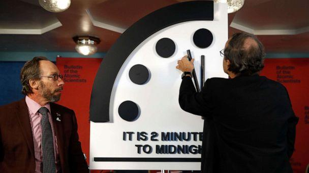 PHOTO: Robert Rosner, right, joined by Bulletin of the Atomic Scientists member Lawrence Krauss, left, moves the minute hand of the Doomsday Clock to two minutes to midnight during a news conference at the National Press Club in Washington, Jan. 25, 2018. (Carolyn Kaster/AP, FILE)