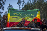 FILE - In this Saturday, May 22, 2021 file photo, supporters attend an election rally of the Ethiopian Citizens for Social Justice (EZEMA) opposition party, also attended by party leader Berhanu Nega, at Agena town in the Southern Nations, Nationalities, and Peoples' Region of Ethiopia. The country is due to vote in a general election on Monday, June, 21, 2021. (AP Photo/Mulugeta Ayene, File)
