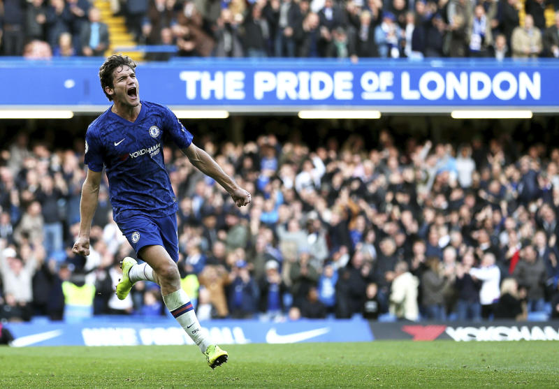 Chelsea's Marcos Alonso celebrates scoring his side's first goal during the British Premier League soccer match between Newcastle United and Chelsea, at Stamford Bridge, London, Saturday, Oct. 19, 2019. (Steven Paston/PA via AP)