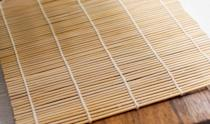 """It might sound weird, but a bamboo sushi mat can really come in handy when organizing your beauty supplies. According to <a rel=""""nofollow noopener"""" href=""""http://irinascutebox.blogspot.com/2013/02/how-to-make-brush-organizer.html"""" target=""""_blank"""" data-ylk=""""slk:Irina's Cute Box"""" class=""""link rapid-noclick-resp"""">Irina's Cute Box</a>, weaving a thick piece of elastic throughout the mat creates slots for your brushes to slide into. And when you're done using them, you can simply roll it up until next time."""