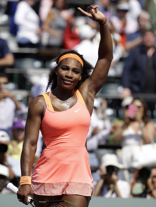 Serena Williams waves to the crowd after defeating Sabine Lisicki during their quarterfinal match at the Miami Open tennis tournament, Wednesday, April 1, 2015, in Key Biscayne, Fla. Williams won the match 7-6 (4), 1-6, 6-3. (AP Photo/Lynne Sladky)