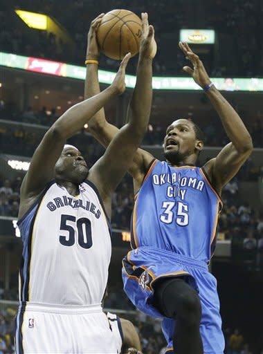 Memphis Grizzlies power forward Zach Randolph (50) and Oklahoma City Thunder small forward Kevin Durant (35) vie for a loose ball in first half of Game 3 in a Western Conference semifinal NBA basketball playoff series in Memphis, Tenn., Saturday, May 11, 2013. (AP Photo/Danny Johnston)
