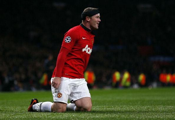 Manchester United's Wayne Rooney celebrates scoring a goal during the UEFA Champions League against Bayer Leverkusen