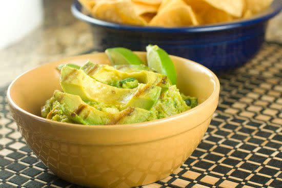 "<strong>Get the <a href=""http://www.macheesmo.com/2012/06/grilled-guacamole/"" rel=""nofollow noopener"" target=""_blank"" data-ylk=""slk:Grilled Guacamole recipe"" class=""link rapid-noclick-resp"">Grilled Guacamole recipe</a> from Macheesmo</strong>"
