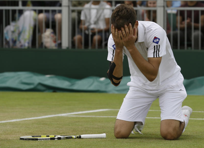 Jerzy Janowicz of Poland reacts after beating Jurgen Melzer of Austria during their Men's singles match at the All England Lawn Tennis Championships in Wimbledon, London, Monday, July 1, 2013. (AP Photo/Anja Niedringhaus)