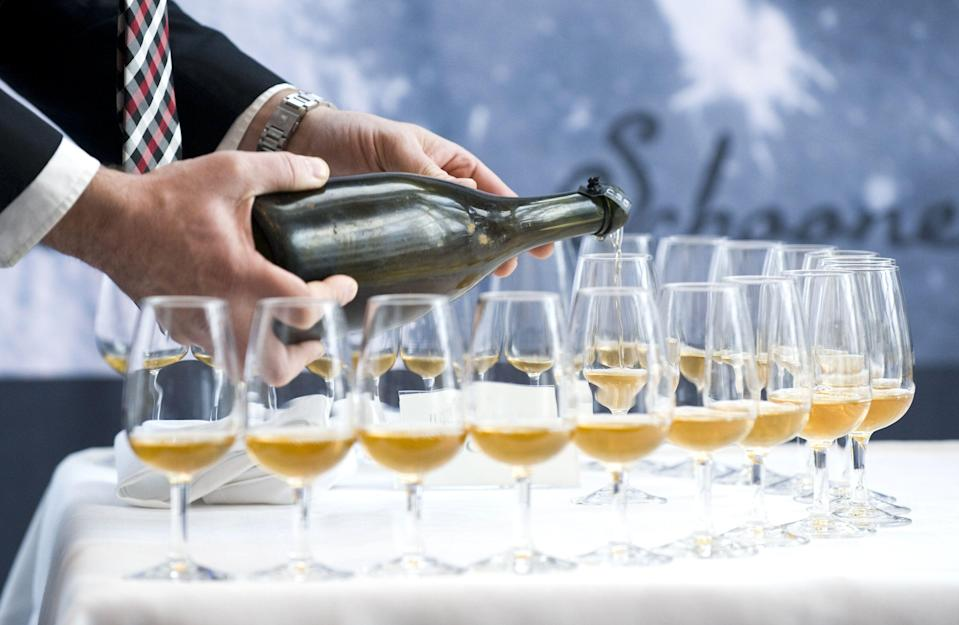 TO GO WITH AFP STORY BY AIRA-KATARIINA VEHASKARI A man pours a 200-year-old champagne, on November 17, 2010 in Mariehamn. Finnish officials pop the cork of a 200-year-old bottle of champagne, after 70 bottles of what is believed to be the world's oldest bubbly were discovered on July 2010 in a shipwreck, at a depth of fifty meters, southeast of Mariehamn, on the southwestern Finnnish Aaland Islands of the Baltic Sea. AFP PHOTO/JONATHAN NACKSTRAND (Photo credit should read JONATHAN NACKSTRAND/AFP/Getty Images)