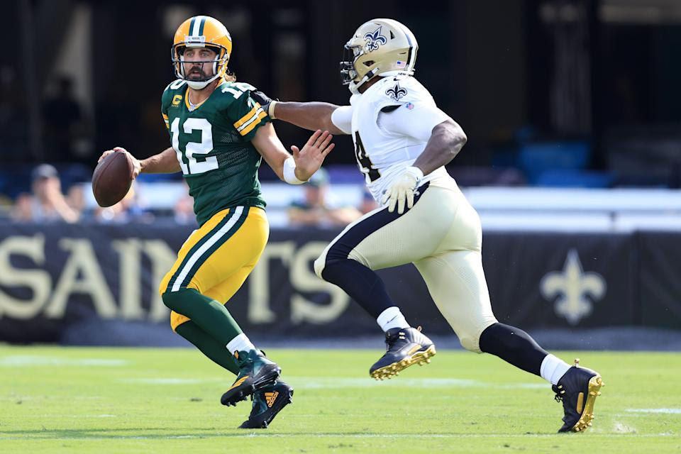 Aaron Rodgers #12 of the Green Bay Packers looks to pass against Cameron Jordan #94 of the New Orleans Saints during the first half at TIAA Bank Field on September 12, 2021 in Jacksonville, Florida.