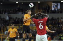 Manchester United's Paul Pogba, front, reacts after fails to score penalty shot during the English Premier League soccer match between Wolverhampton Wanderers and Manchester United at the Molineux Stadium in Wolverhampton, England, Monday, Aug. 19, 2019. (AP Photo/Rui Vieira)