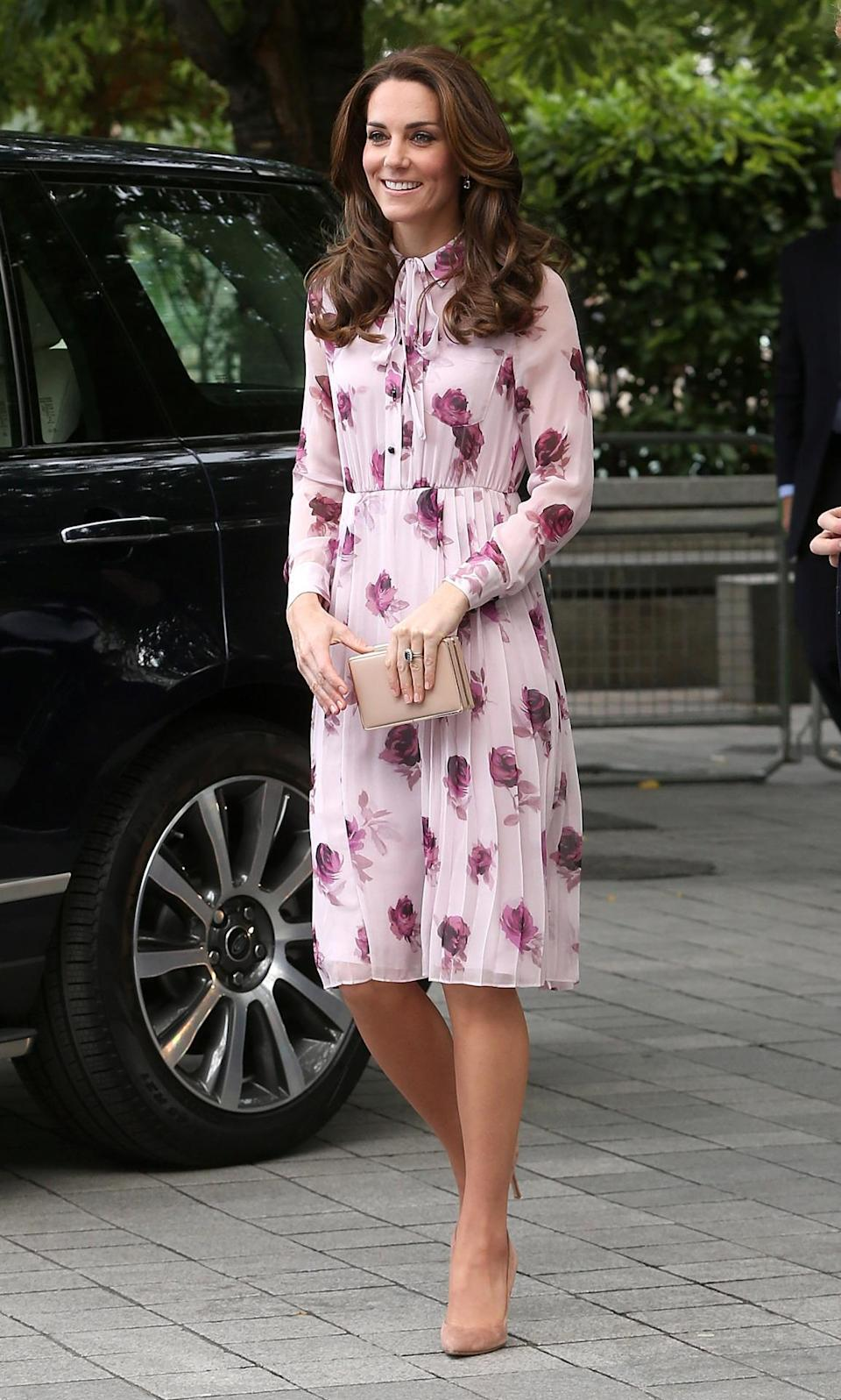 """<p>For a World Mental Health Day engagement, which the Duchess attended with Princes William and Harry, Kate turned to New York brand Kate Spade. Kate wore a version of the <a href=""""http://www.katespade.co.uk/uk/dresses/encore-rose-flutter-dress/invt/njmu6930"""" rel=""""nofollow noopener"""" target=""""_blank"""" data-ylk=""""slk:Encore Rose dress"""" class=""""link rapid-noclick-resp"""">Encore Rose dress</a>, which costs £405. </p><p><i>[Photo: Getty]</i> <br></p>"""