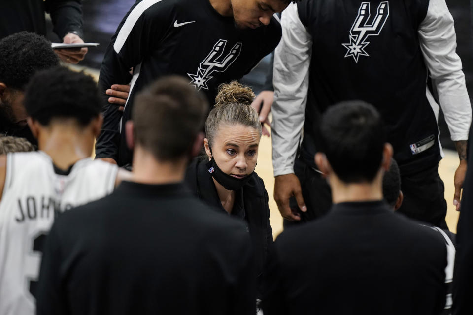 San Antonio Spurs assistant coach Becky Hammon calls a play during a timeout in the second half of an NBA basketball game against the Los Angeles Lakers in San Antonio, Wednesday, Dec. 30, 2020. (AP Photo/Eric Gay)