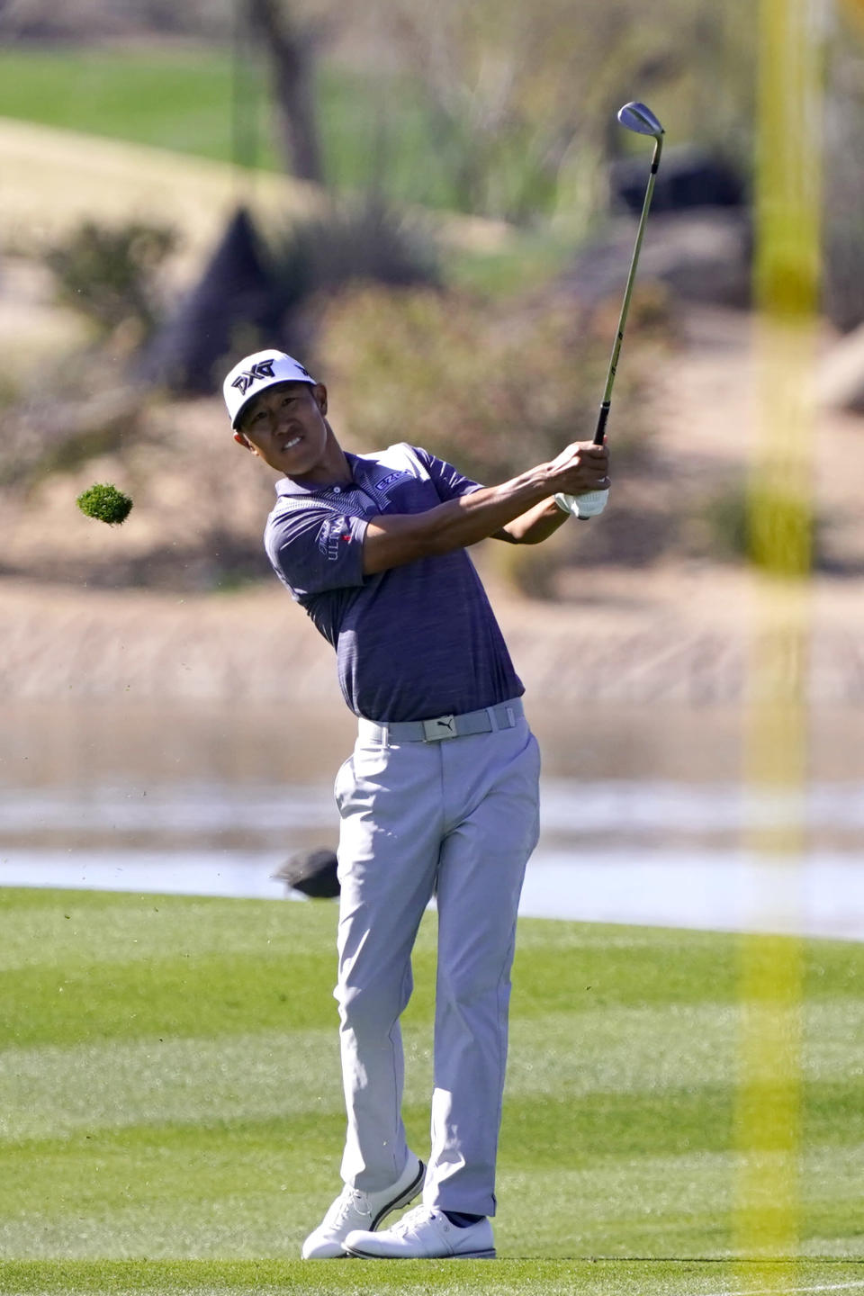 James Hahn hits his approach shot on the 15th hole during the final round of a PGA golf tournament on Sunday, Feb. 7, 2021, in Scottsdale, Ariz. (AP Photo/Rick Scuteri)