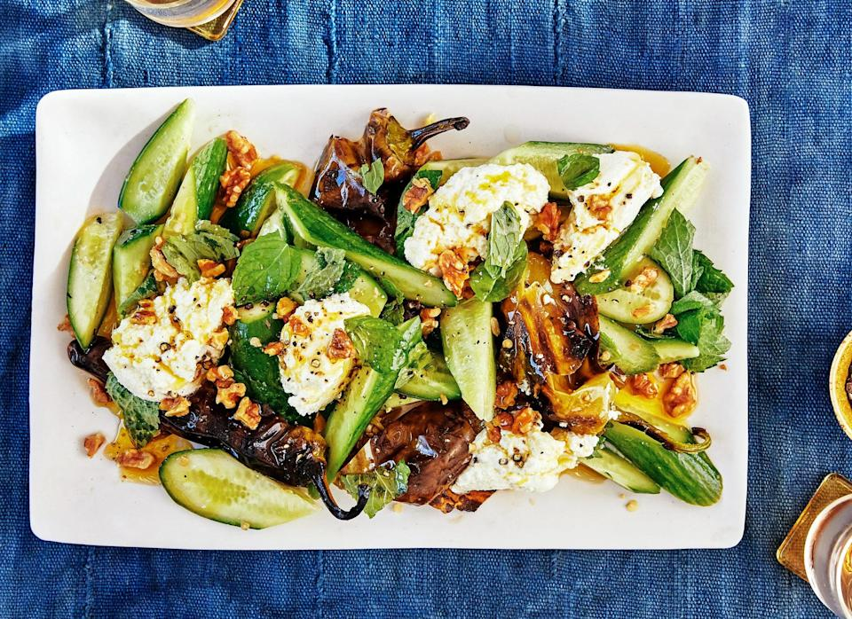 "The smoky charred peppers play well with the cool cucumbers and lemony ricotta. If you can't find Italian frying peppers or just aren't feeling them, grilled eggplant or zucchini would also work well here. <a href=""https://www.bonappetit.com/recipe/charred-peppers-with-lemon-ricotta-and-cucumbers?mbid=synd_yahoo_rss"" rel=""nofollow noopener"" target=""_blank"" data-ylk=""slk:See recipe."" class=""link rapid-noclick-resp"">See recipe.</a>"