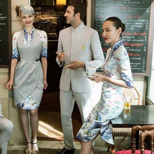 Men's version of the uniform is a bit less extravagant and Western-looking, with double-breasted overcoats and smaller elements of the traditional Chinese culture. Photo: Hainan Airlines