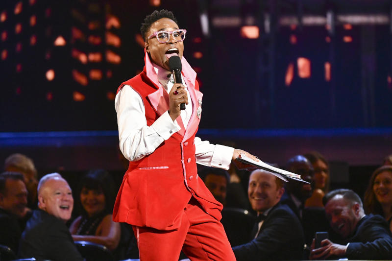 """FILE - This June 9, 2019 file photo shows Billy Porter speaking at the 73rd annual Tony Awards in New York. Many A-listers have been wearing more vintage pieces and re-wearing outfits, something unheard of among many celebrities. Porter's outfit was made from curtains from the Tony Award-winning musical """"Kinky Boots."""" (Photo by Charles Sykes/Invision/AP)"""