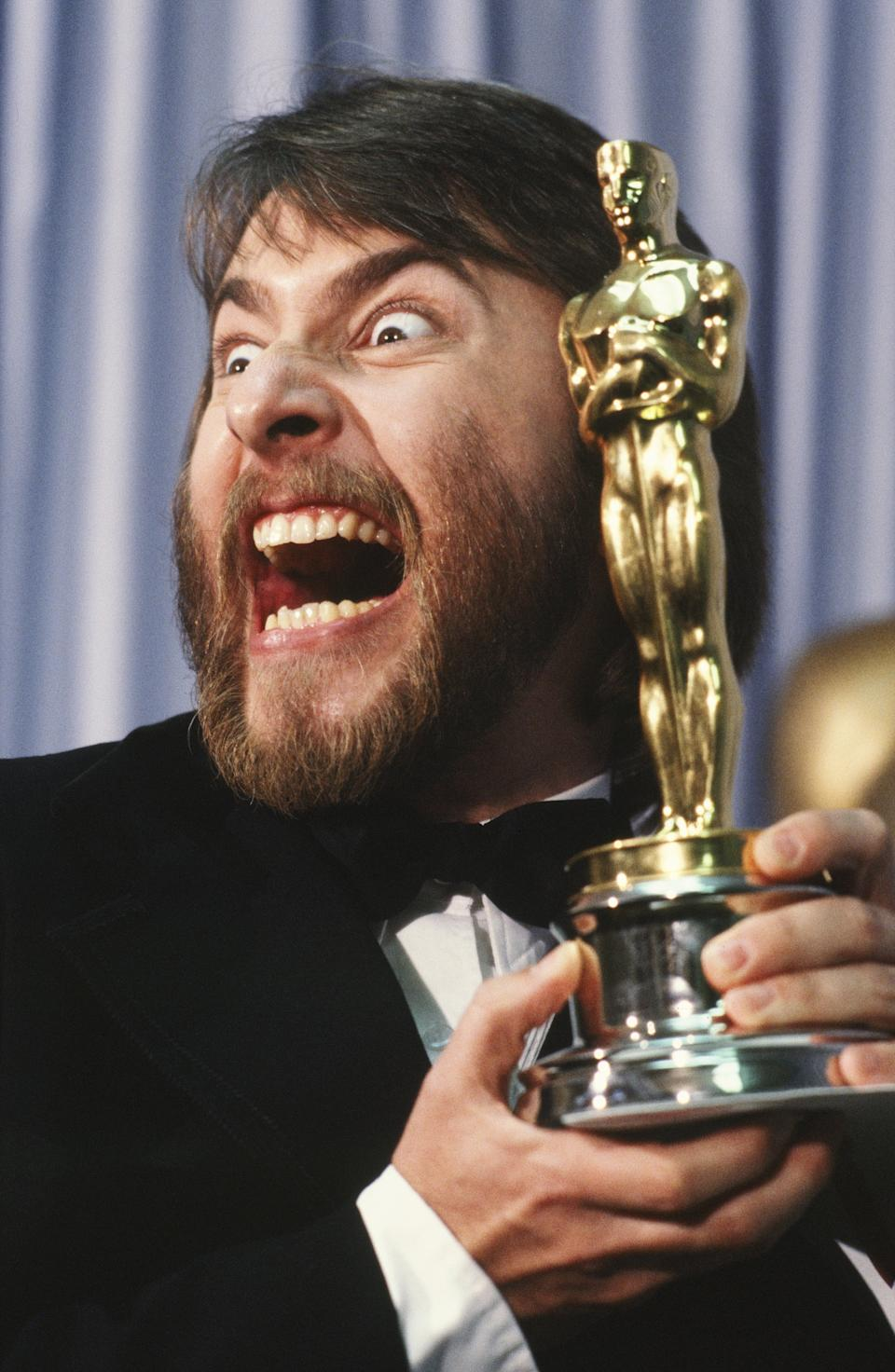 LOS ANGELES, CA - 1981:  Academy Award-winning makeup artist, Rick Baker, poses in a 1981 Los Angeles, California, backstage photo shoot with his Oscar. Baker won the award for his work on the film