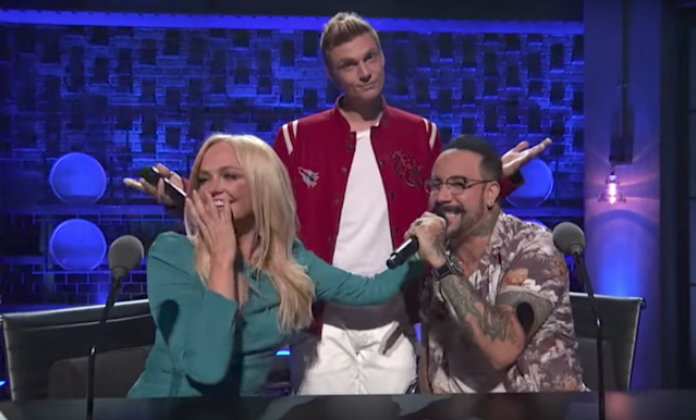 "Nick Carter and A.J. McLean serenade Emma ""Baby Spice"" Bunton on <em>Boy Band</em>. (Photo: ABC)"