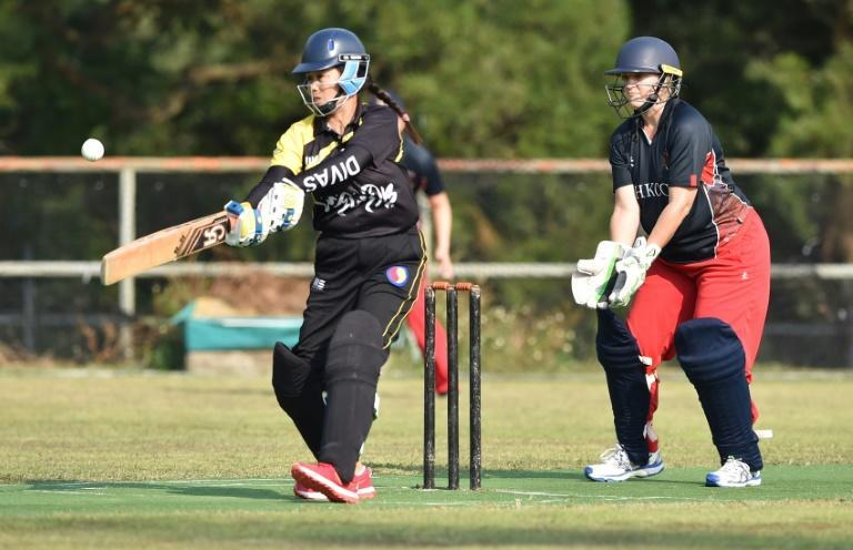 """""""We are all domestic helpers"""": SCC Divas Cricket Team, made up enitrely of Filipinos, bat during a match in Hong Kong"""