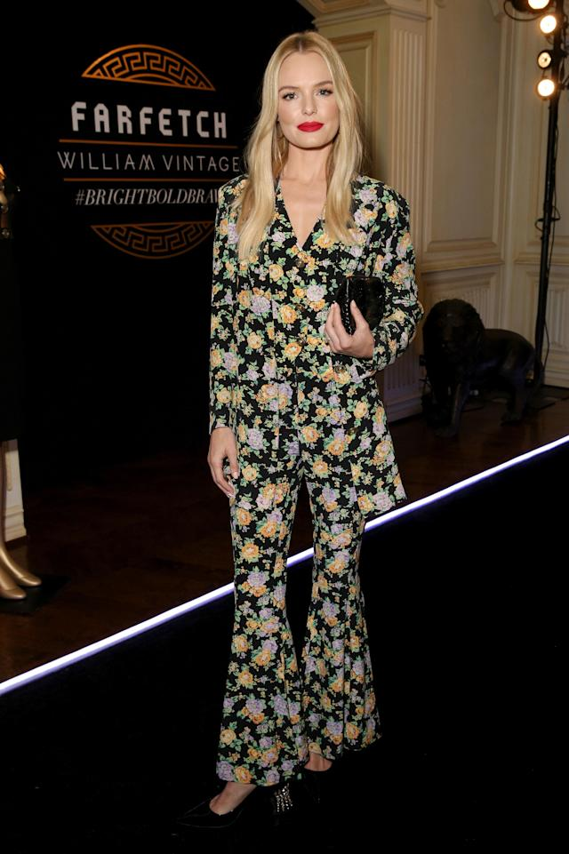 <p>Bosworth looked like she was standing in a field of flowers at an event to celebrate the Gianni Versace archive. Her simple long and loose locks and pop of red lon the lips balanced out the bold print. (Photo: Getty Images) </p>