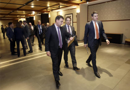 Attendees at the NHL board of governors meeting leave the conference room at the end of the day. (AP)