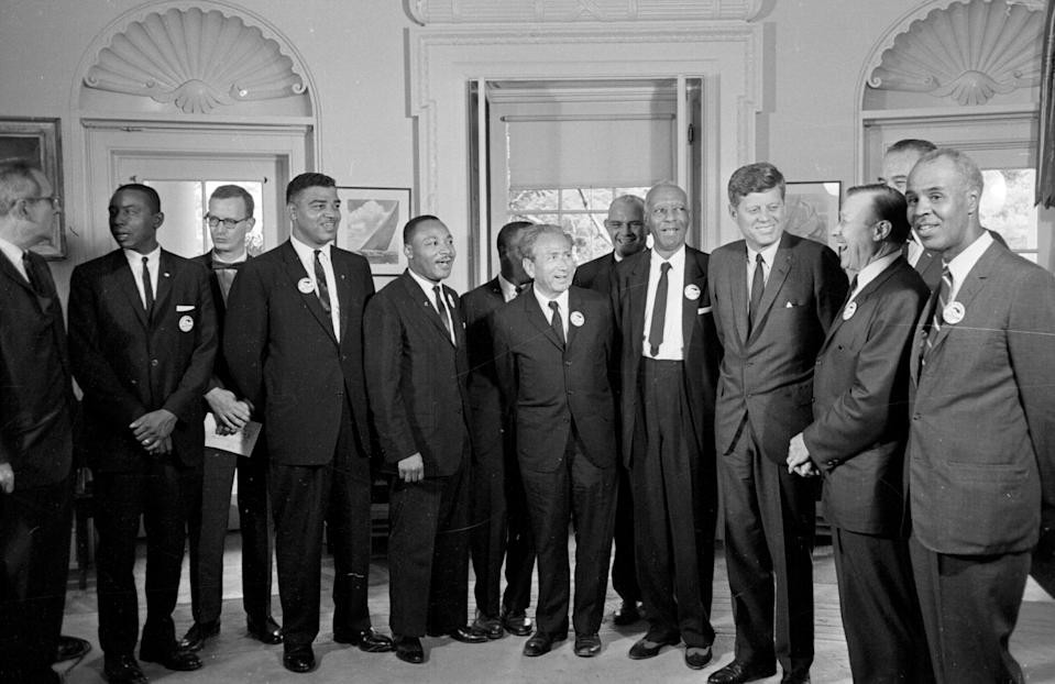 A 1963 file photo of President John F. Kennedy stands with a group of leaders of the March on Washington, at the White House. From left are Whitney Young, National Urban League; Martin Luther King Jr., Southern Christian Leadership Conference; John Lewis, Student Non-violent Coordinating Committee; Rabbi Joachim Prinz, American Jewish Congress; Dr. Eugene P. Donnaly, National Council of Churches; A. Philip Randolph, AFL-CIO vice president; Kennedy; Walter Reuther, United Auto Workers; Vice-President Johnson, rear, and Roy Wilkins, NAACP. Source: AP