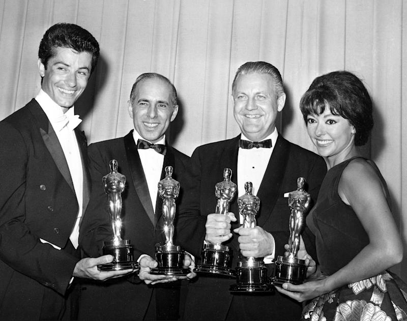 """FILE - In this April 9, 1962 file photo, Oscar winners for """"West Side Story,"""" from left, actor George Chakiris, co-directors Jerome Robbins and Robert Wise, and actress Rita Moreno, pose at the Academy Awards in Santa Monica, Calif. Moreno is the 50th SAG Life Achievement recipient, to be honored at the Screen Actors Guild Awards, Saturday, Jan. 18, 2014, in Los Angeles. (AP Photo, File)"""