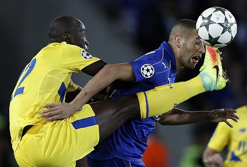 Porto's Portuguese midfielder Danilo (L) vies with Leicester City's Algerian striker Islam Slimani during their UEFA Champions League group G match in Leicester on Septemeber 27, 2016