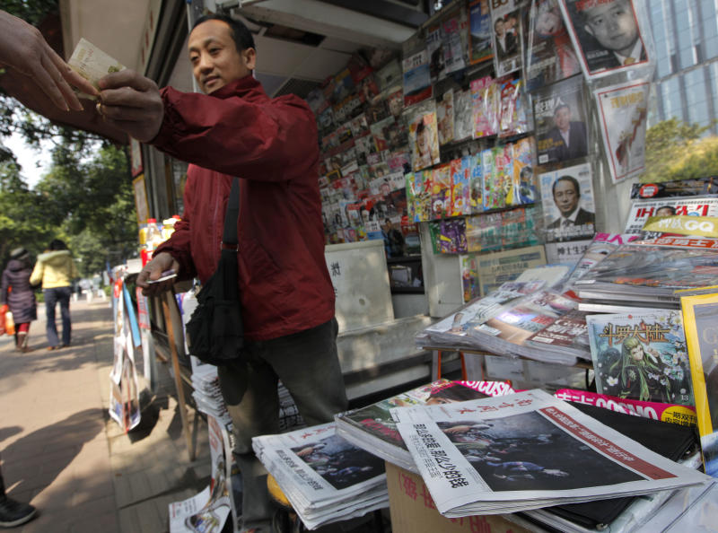 In this Thursday, Jan. 10, 2013 photo, a man buys a latest edition of the Southern Weekly at a newspaper stand near the Southern Weekly headquarters in Guangzhou, Guangdong province, China. China's new Communist Party leaders want to appear more open, but they're not about to give up control of the media. That's the lesson of a dustup involving the influential newspaper whose staff briefly rebelled against especially heavy-handed censorship. The staff of Southern Weekly returned to work after some controls were relaxed, but public demands for the ouster of the top censor were ignored. (AP Photo/Vincent Yu)