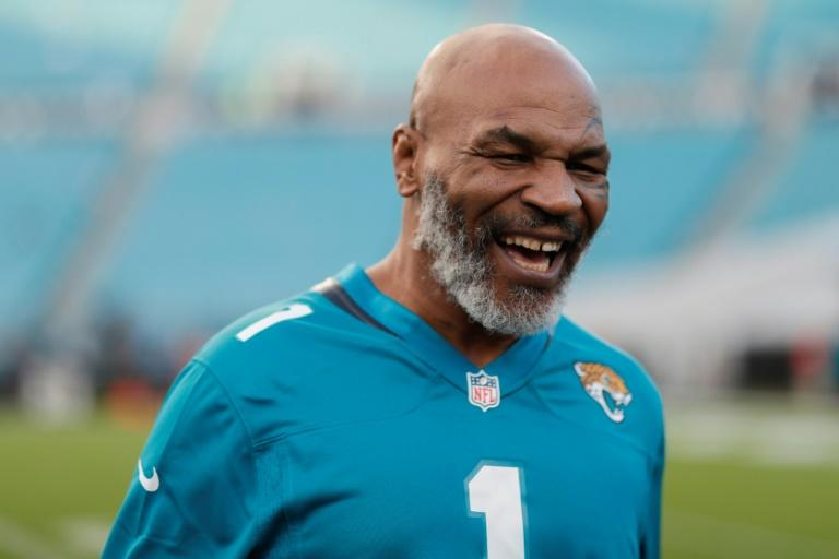 Former world heavyweight boxing champion Mike Tyson said Thursday he is making a comeback at age 54 in an eight-round exhibition bout against Roy Jones Jr. in Los Angeles on September 12