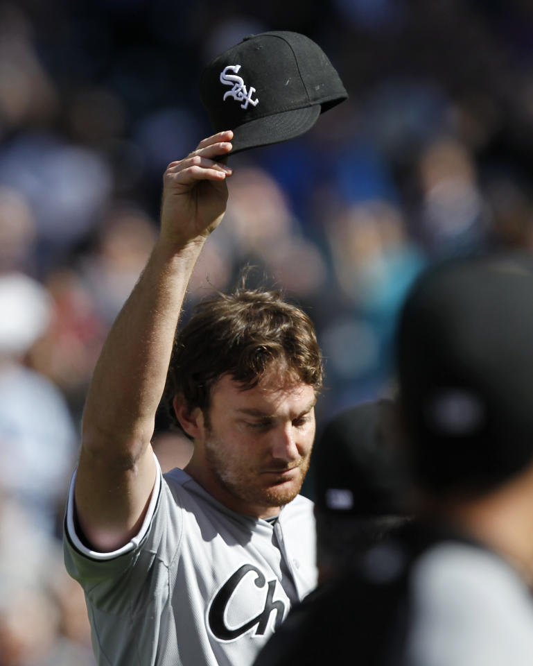 Chicago White Sox starting pitcher Phil Humber waves his cap after pitching a perfect baseball game against the Seattle Mariners, Saturday, April 21, 2012, in Seattle. The White Sox won 4-0. (AP Photo/Elaine Thompson)