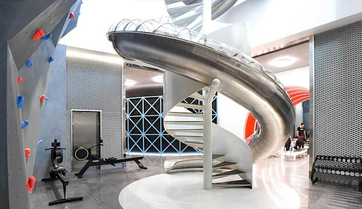 A curving metallic slide sits at the center of Beijing's new MFIT SPACE 01 gym.