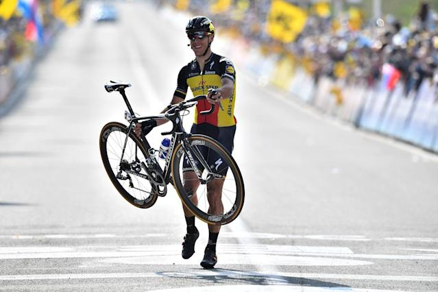 Belgian cyclist Philippe Gilbert of Quick-Step Floors gets off his bike to cross the finish line and win the 101st edition of the Ronde van Vlaanderen - Tour des Flandres - Tour of Flanders one day cycling race, a 260km race from Antwerp to Oudenaarde, on April 2, 2017. (AFP Photo/ERIC LALMAND)