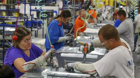 Workers assemble built-in appliances at the Whirlpool manufacturing plant in Cleveland