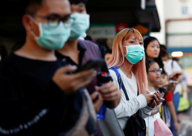 Too close? Singapore's new virus-fighting rules could lead to prison