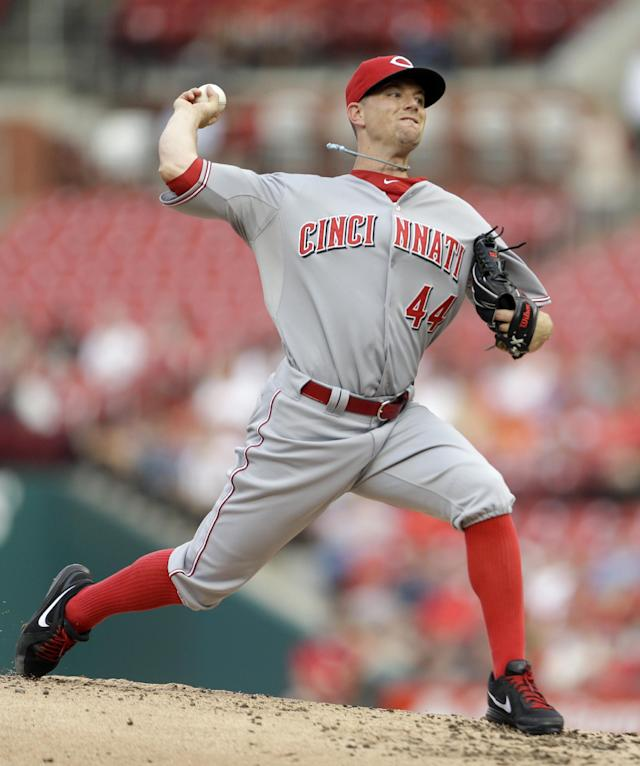 Cincinnati Reds starting pitcher Mike Leake throws during the first inning of a baseball game against the St. Louis Cardinals Monday, Aug. 26, 2013, in St. Louis. (AP Photo/Jeff Roberson)
