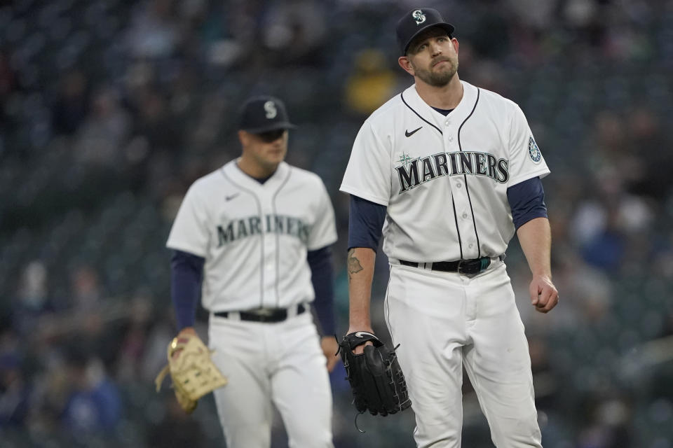 Seattle Mariners starting pitcher James Paxton, right, reacts on the mound after an injury during the second inning of the team's baseball game against the Chicago White Sox, Tuesday, April 6, 2021, in Seattle. Paxton left the game and was replaced by Nick Margevicius. (AP Photo/Ted S. Warren)