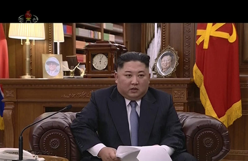 In this undated image from video distributed on Tuesday Jan. 1 2019 by North Korean broadcaster KRT North Korean leader Kim Jong Un delivers a speech in North Korea. North Korean leader Kim says he hopes to extend his high-stakes nuclear summitry with
