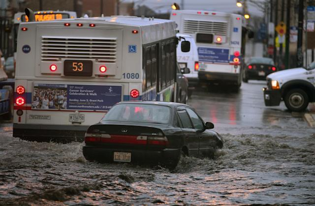 CHICAGO, IL - APRIL 18: A motorist drives through standing water in a flooded underpass on April 18, 2013 in Chicago, Illinois. Thunderstorms dumped up to 5 inches of rain on parts of the Chicago area overnight, closing sections the Edens, Eisenhower and Kennedy expressways, which lead into downtown, during the morning rush. (Photo by Scott Olson/Getty Images)