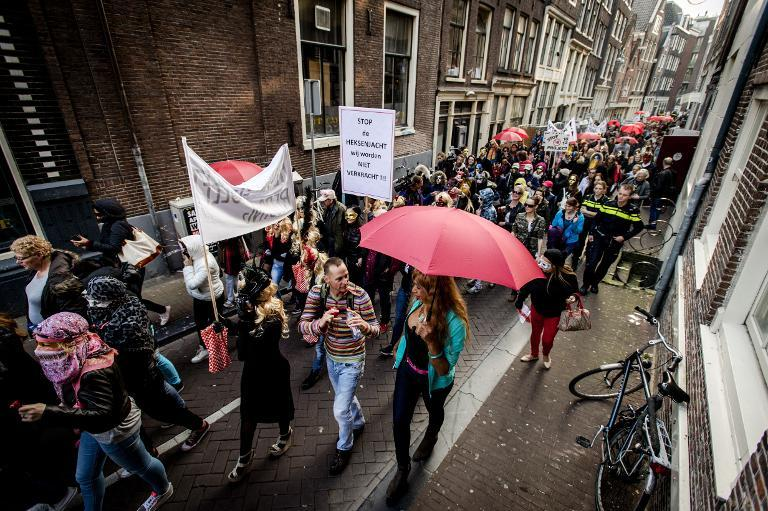 Sex workers and sympathizers demonstrate on April 9, 2015 against the closure of window brothels by the municipality in the red light district in Amsterdam