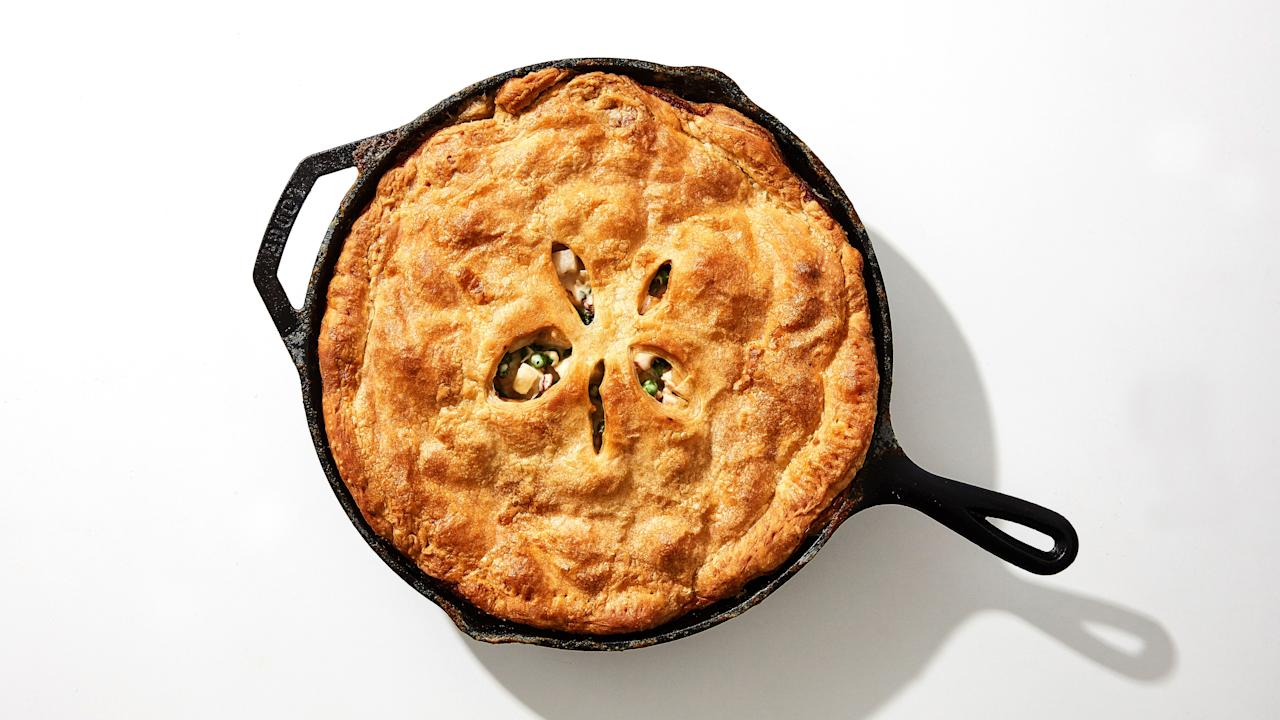 """Who doesn't like chicken pot pie? Rotisserie chicken, store-bought puff pastry, and just one skillet keep this hearty dinner recipe from feeling too fussy—or taking all day to make. If you've never worked with frozen puff pastry before, know this: Letting it thaw overnight in the fridge overnight is non-negotiable. If you try to work with puff pastry that is not fully thawed, it'll crack and become a whole mess, and nobody wants that. But just the smallest bit of planning ahead will be rewarded with buttery, flaky, pot pie perfection. <a href=""""https://www.bonappetit.com/recipe/one-skillet-rotisserie-chicken-pot-pie?mbid=synd_yahoo_rss"""">See recipe.</a>"""