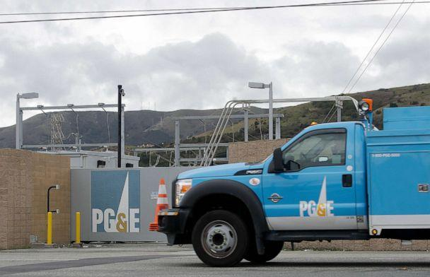 PHOTO: A Pacific Gas & Electric truck drives past a PG&E entrance in Daly City, Calif., Feb. 1, 2019. (Jeff Chiu/AP, FILE)