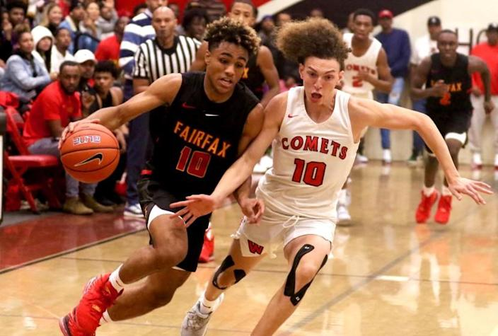 Fairfax guard Spencer Dinwiddie drives against Westchester's T.J. Wainwright during their Western League game on Dec. 13, 2019.