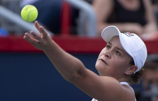 Ashleigh Barty of Australia tosses the ball to serve to Kiki Bertens of the Netherlands during quarter-finals play at the Rogers Cup tennis tournament Friday, Aug. 10, 2018 in Montreal. (Paul Chiasson/The Canadian Press via AP)