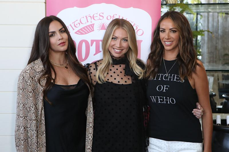 Katie Maloney-Schwartz (left), Stassi Schroeder (middle) and Kristen Doute (right) pose with their arms around each other